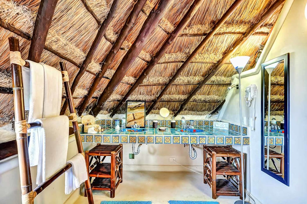 Baños de estilo rústico de DHI Riviera Maya Architects & Contractors Rústico