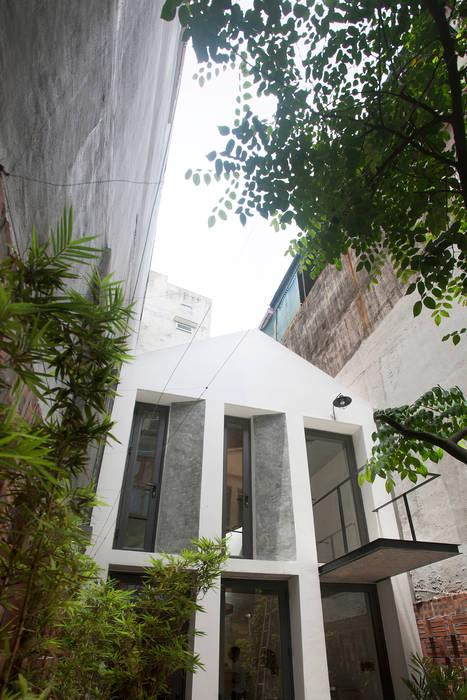 Casas de estilo  por NGHIA-ARCHITECT , Moderno
