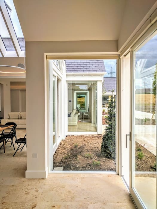 open plan spaces linked through a series of glazed gardens:  Living room by Jane D Burnside Architects