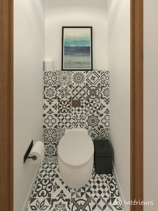 Les toilettes: Salle de bains de style  par MJ Intérieurs