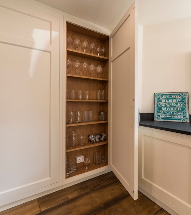 Shallow cupboard for glasses.: classic Kitchen by John Gauld Photography