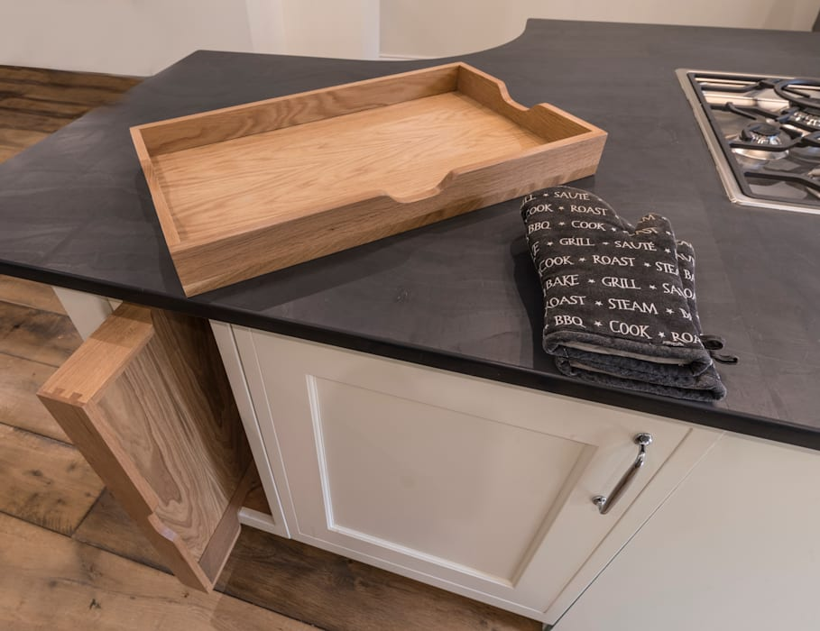 Wooden trays fit a bespoke space:  Kitchen by John Gauld Photography