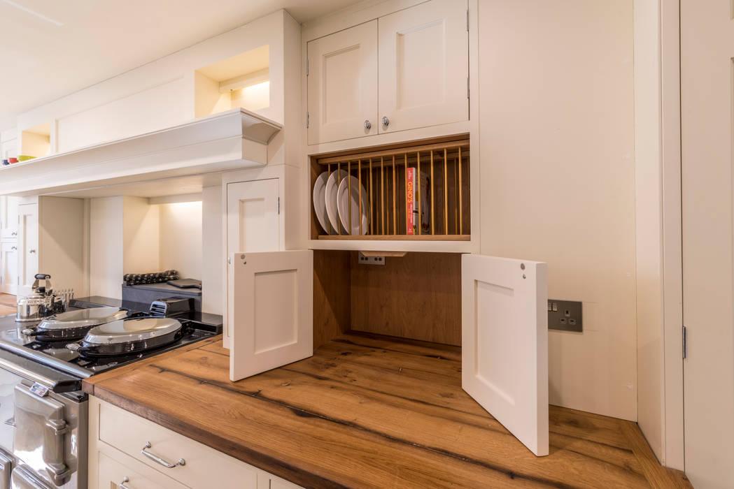 Bespoke wooden cupboard:  Kitchen by John Gauld Photography