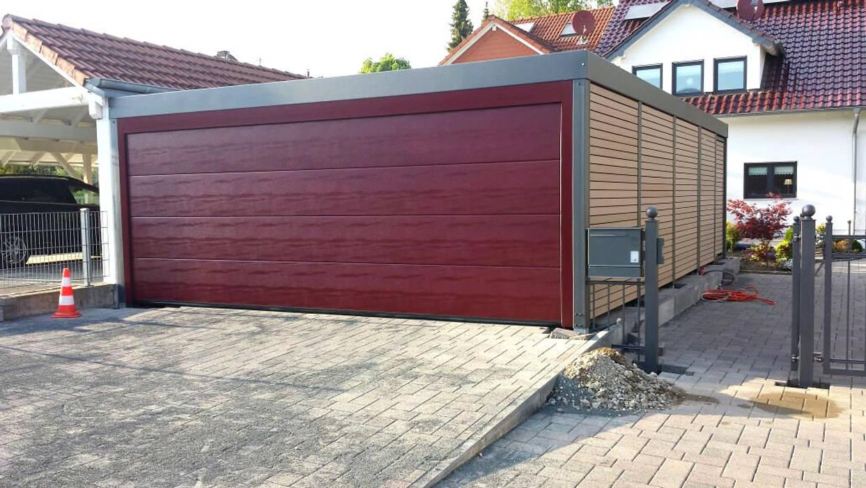 Stahlcarport mit elektrischem Garagentor:  Carport von Carport-Schmiede GmbH + Co. KG