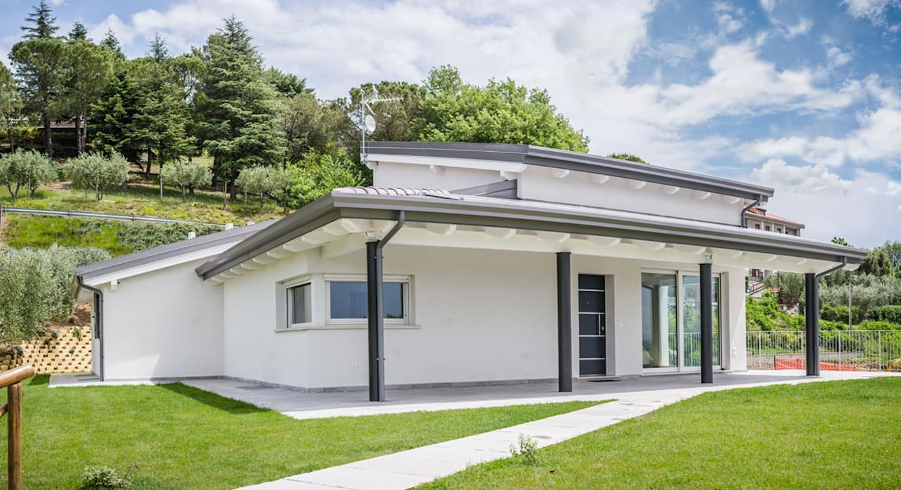 Modern houses by Costantini Case in Legno Modern