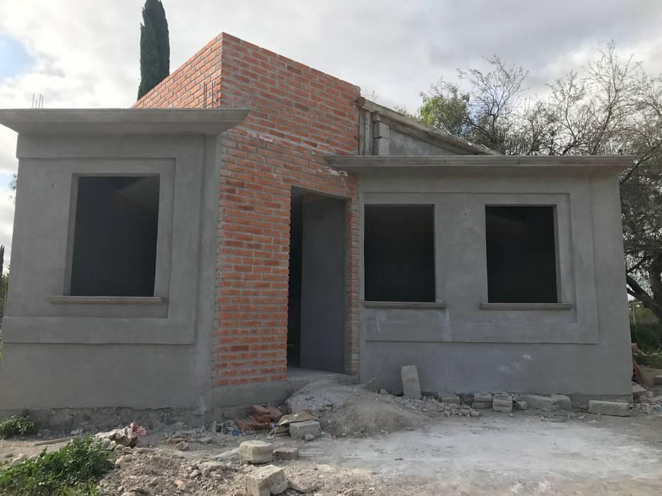 casa-terracota LUBAAL construcción y arquitectura Casas de campo Ladrillos