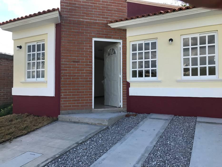 Colonial style houses by LUBAAL construcción y arquitectura Colonial Bricks