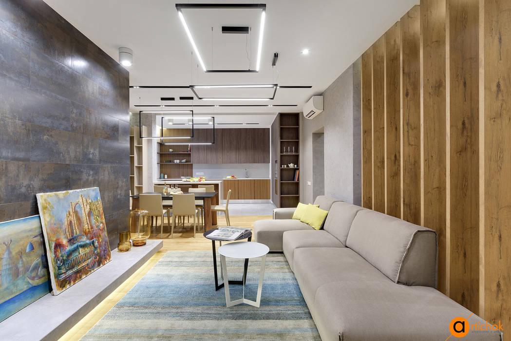 Salones de estilo industrial de Artichok Design Industrial