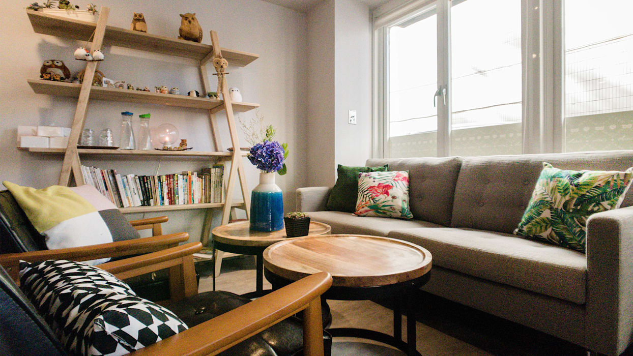 1F Sofa Area:  辦公室&店面 by 見和空間設計