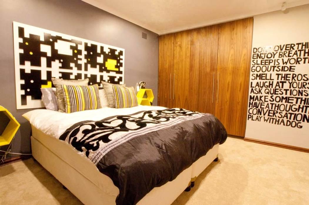 Dormitorios de estilo  de Redesign Interiors, Moderno