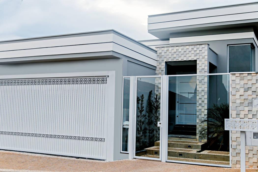 Casas de estilo moderno de Carla Monteiro Arquitetura e Interiores Moderno Piedra