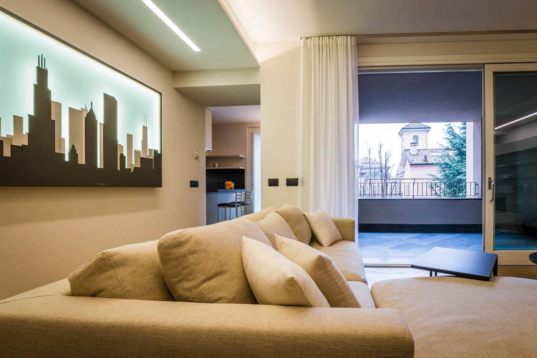 Soggiorno contemporaneo: soggiorno in stile di adidesign* studio ...