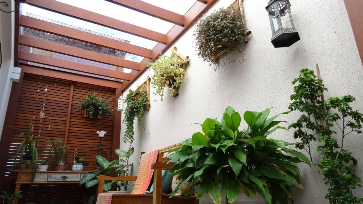 Pergolado Residência Paineiras: Jardins de inverno  por Ambiento Arquitetura