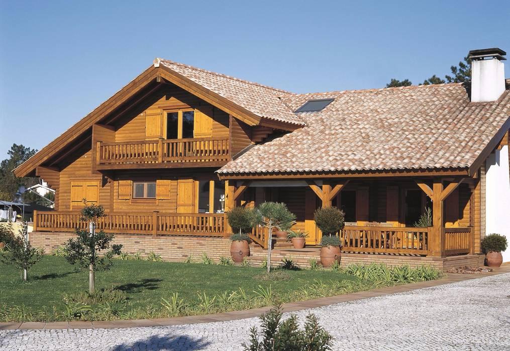 RUSTICASA   Casa Rústica   Aveiro por Rusticasa Rústico Madeira maciça Multicolor