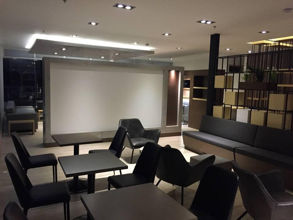 Lounge: Estudios y despachos de estilo  por Bustos + Quintero arquitectos, Moderno