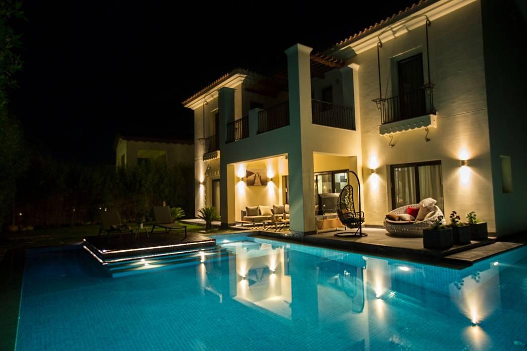 Villa oleh Grid Fine Finishes, Eklektik