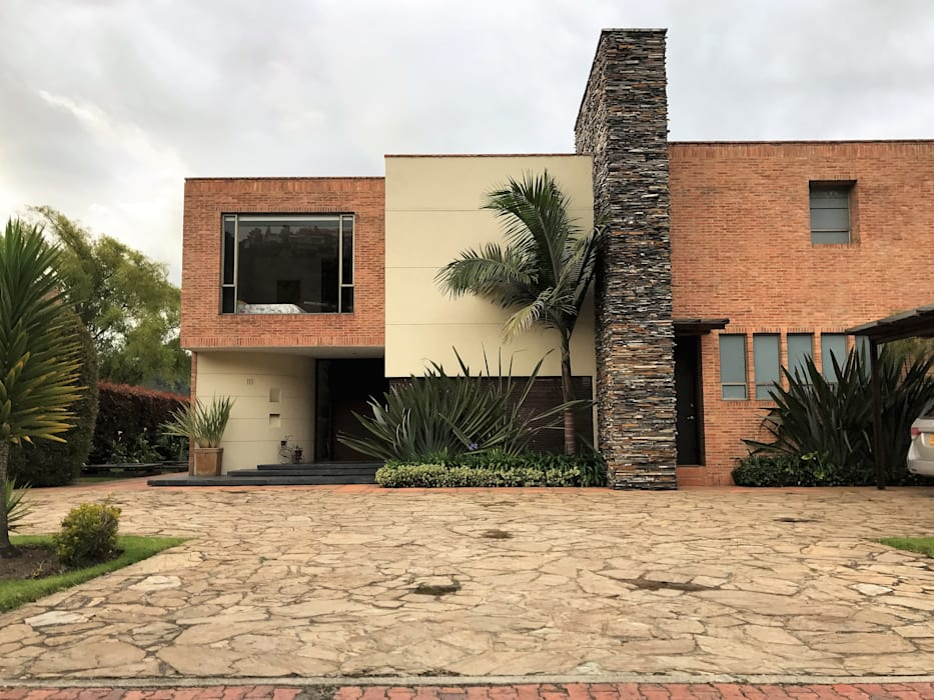 Rumah oleh Arquitectos y Entorno S.A.S, Modern