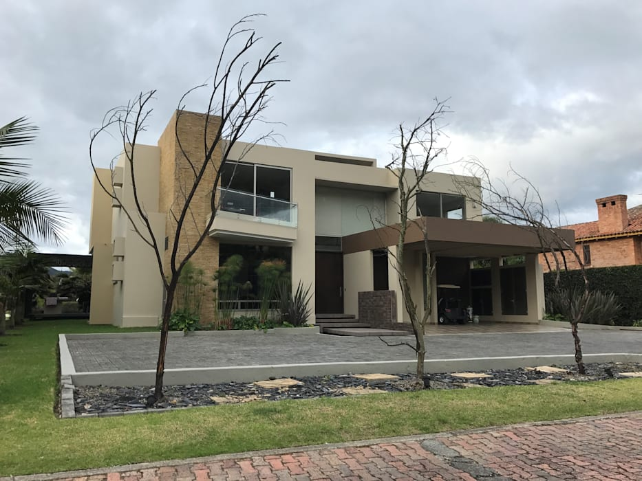Rumah Modern Oleh Arquitectos y Entorno S.A.S Modern
