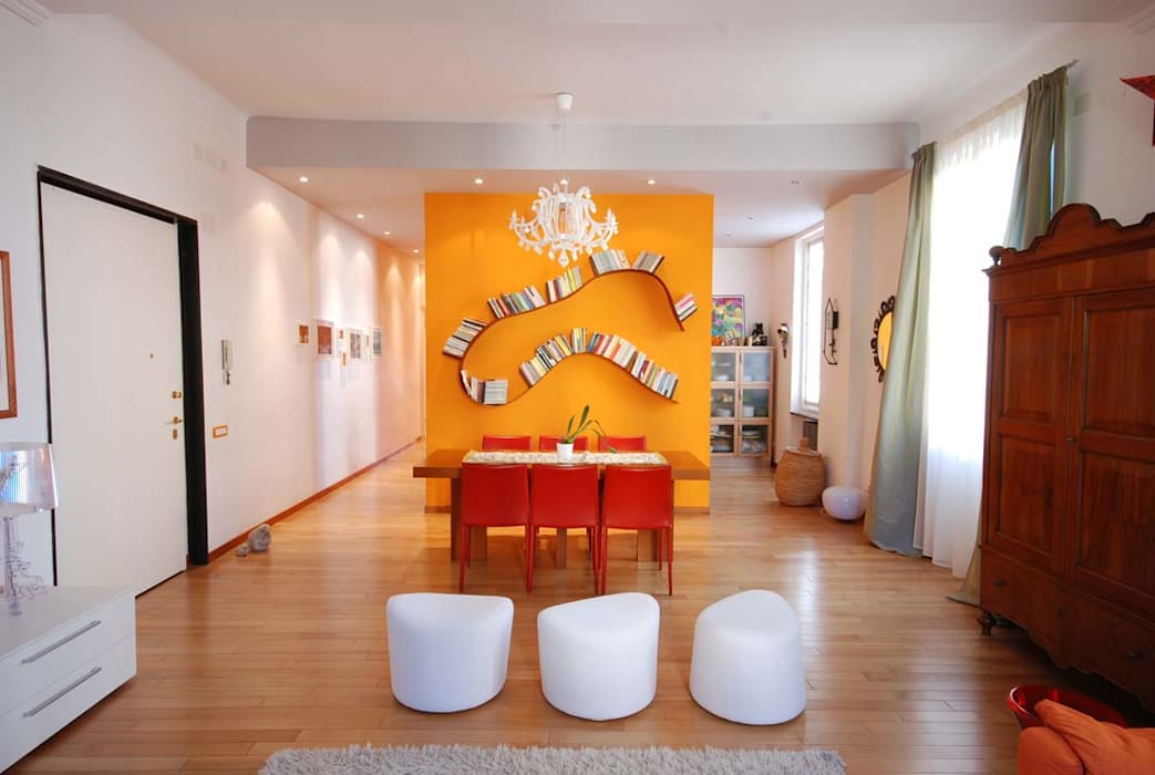 Una casa giocosa con le pareti colorate sala da pranzo for Pareti colorate casa moderna