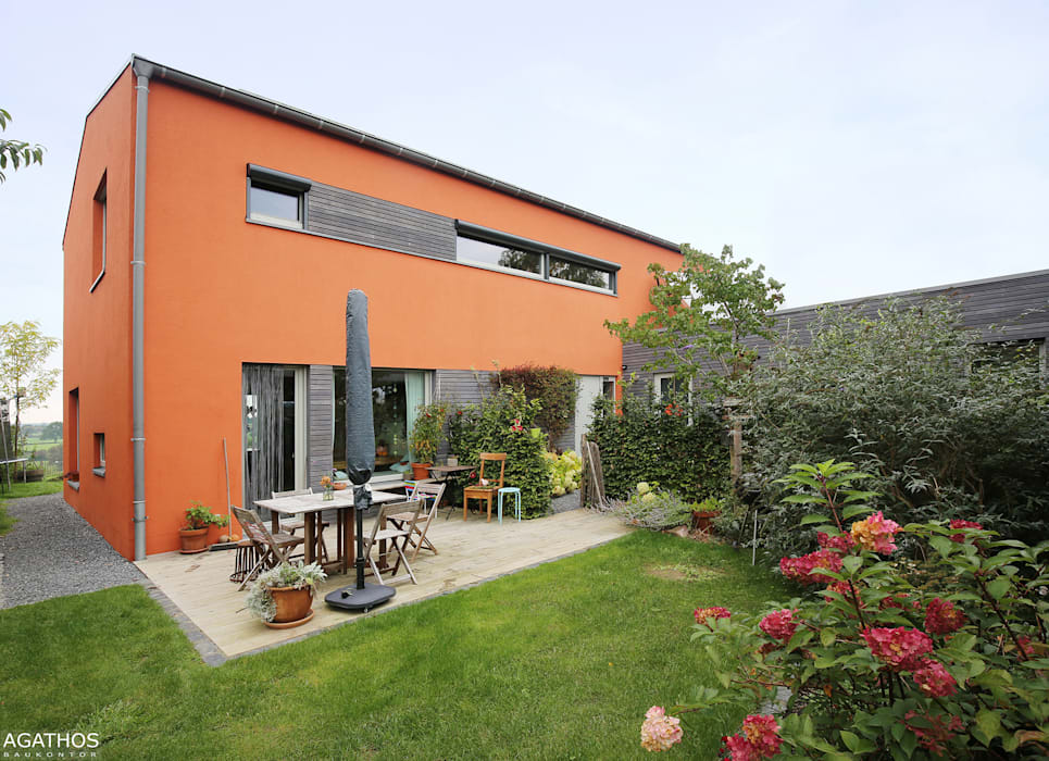 Neubau eines Einfamilienhauses mit Einliegerwohnung:  Häuser von Architekturbüro Sutmann