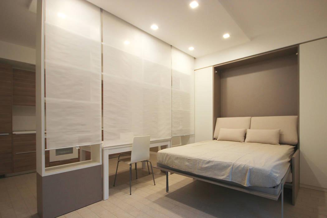 Arredamento di design per un monolocale a milano camera da letto