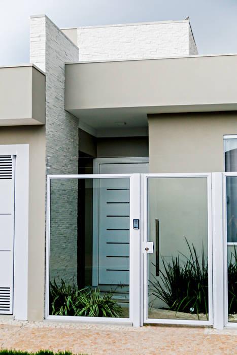 Modern Houses by Carla Monteiro Arquitetura e Interiores Modern
