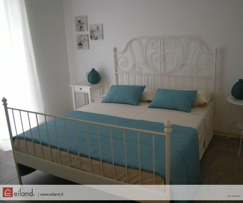 Camere a tema: Camera da letto in stile in stile Classico di EILAND