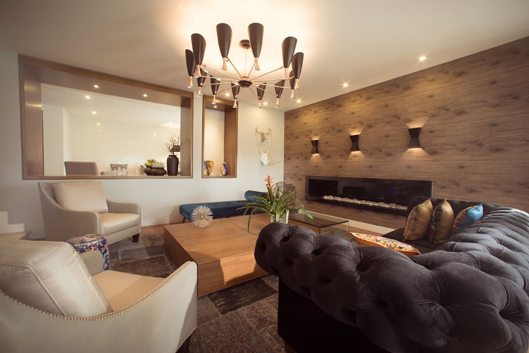 Eclectic style living room by Munera y Molina Eclectic