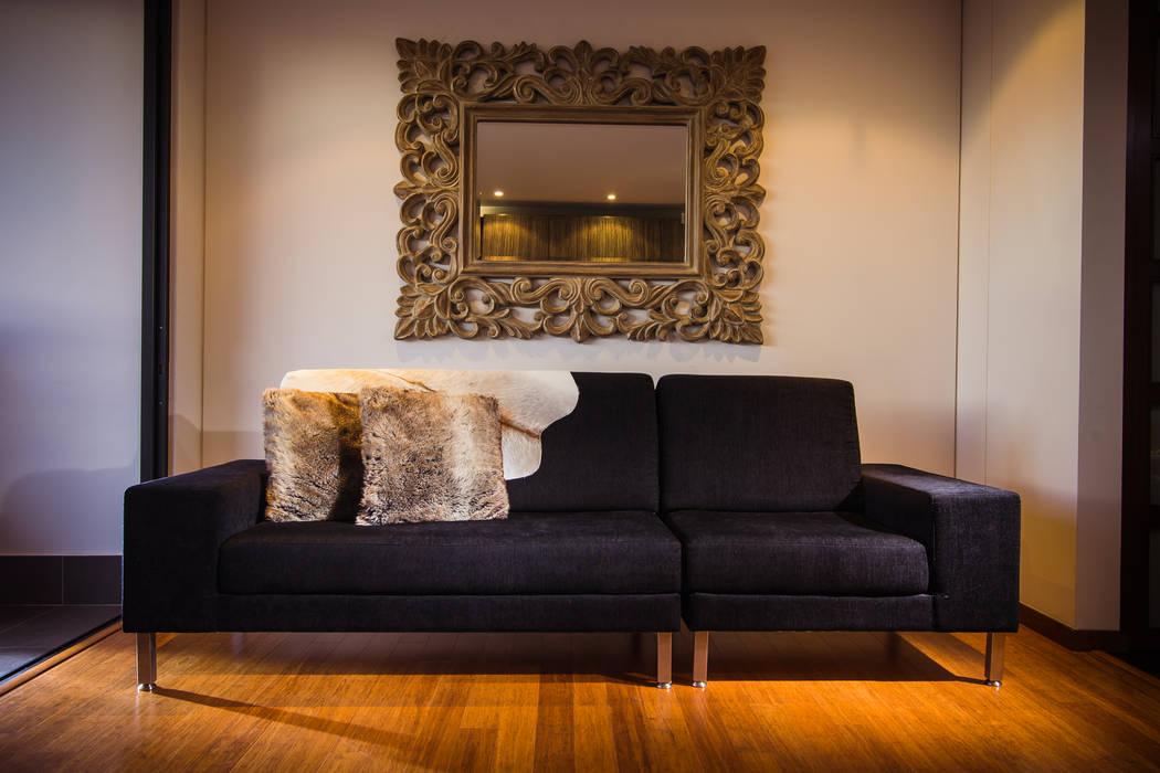 Salas de estilo moderno de Munera y Molina Moderno