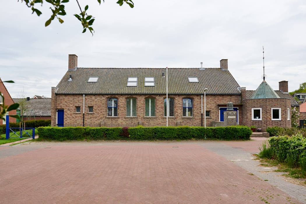 Koepelkerk Onnen - Exterieur:  Huizen door MINT Architecten