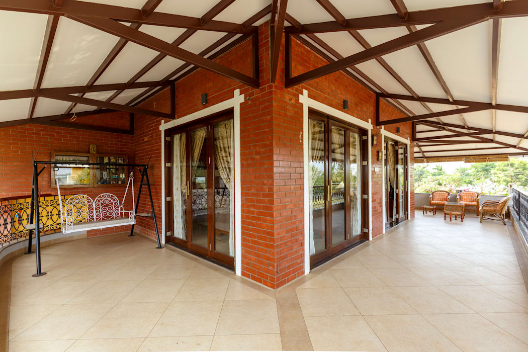 Three Side Verandah for Raised Living Hall. Tropical style living room by homify Tropical Bricks