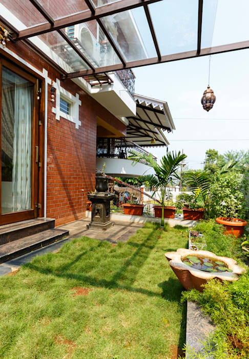 Raised Lawn for Dining:  Garden by Spacecraftt Architects
