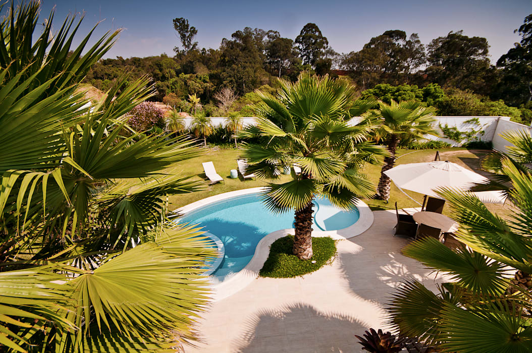 Casa Belvedere Jardins tropicais por Maria Luiza Aceituno arquitetos Tropical