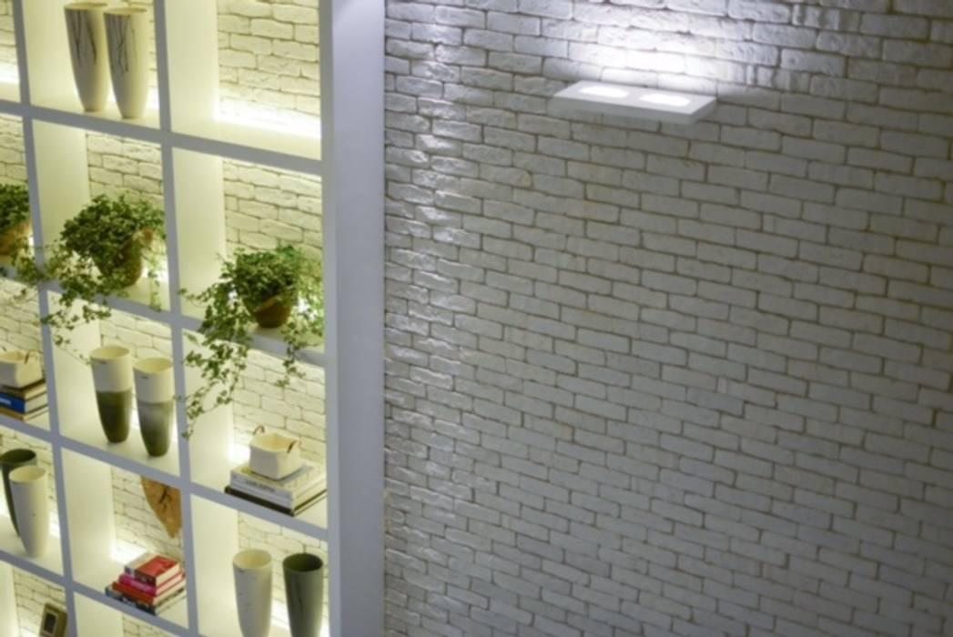 Brique Neve Corredores, halls e escadas modernos por Guaraúna Revestimentos Moderno