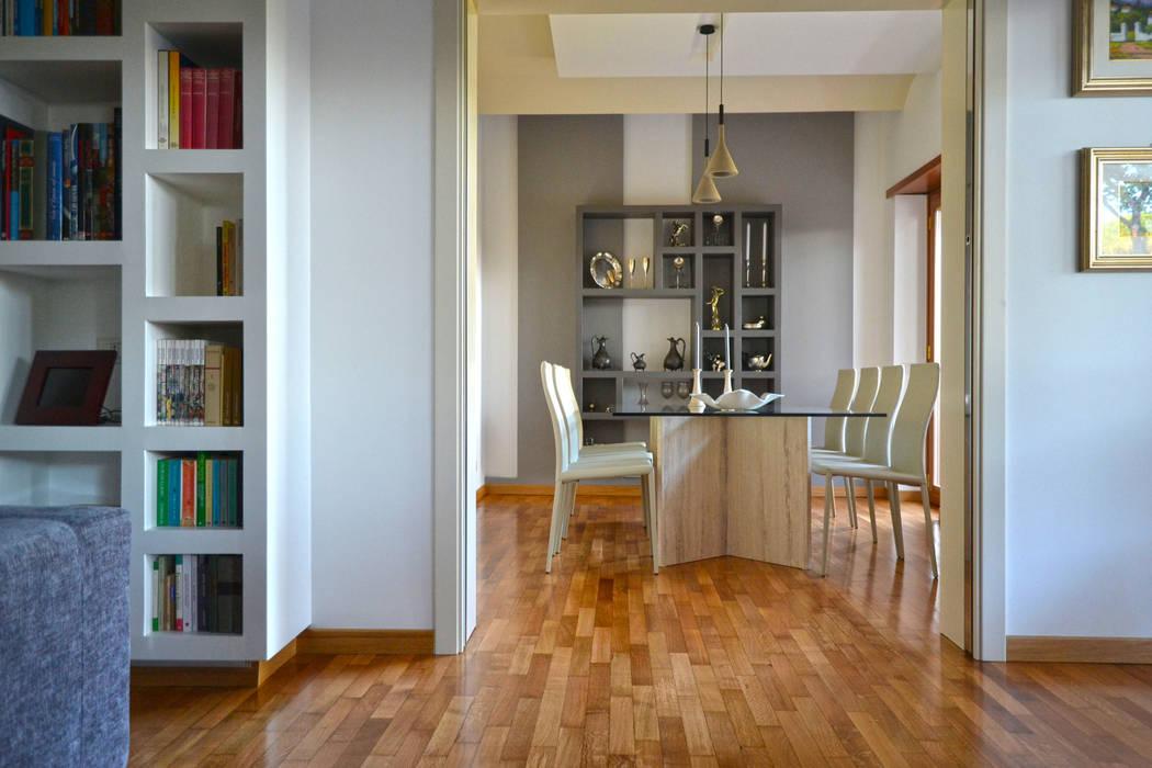 casa ACM - geometria e luce: Sala da pranzo in stile in stile Minimalista di arch. Paolo Pambianchi