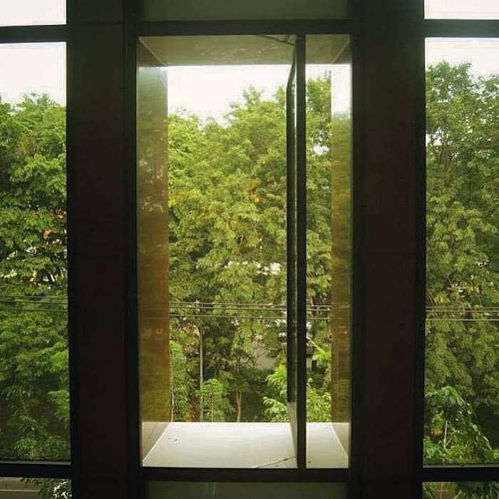 Edificios de oficinas de estilo moderno de Simple Projects Architecture Moderno Aluminio/Cinc