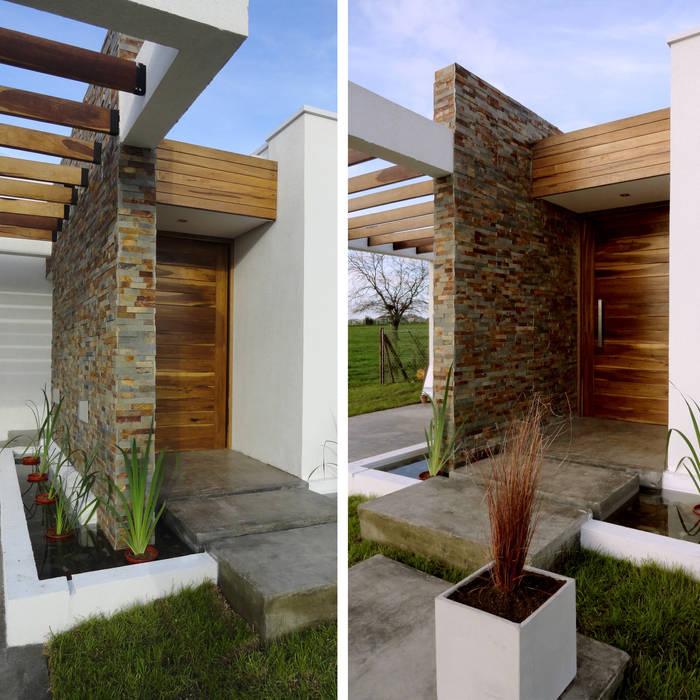 Casa Moderna MAX: Casas de estilo  por Estudio Zanolo