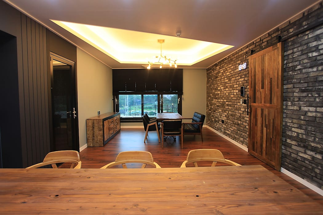 Moderne Wohnzimmer von JUNDESIGN Modern