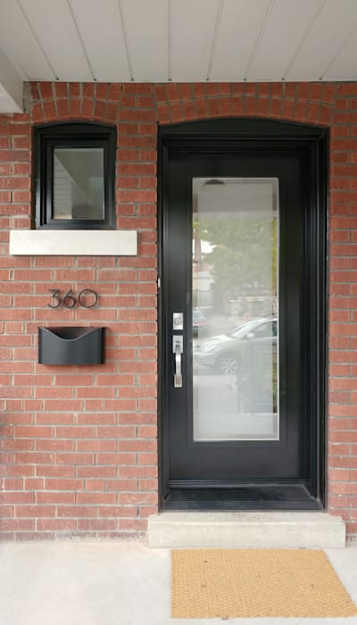 Oakwood Village House - Front Door by Solares Architecture Eclectic Bricks