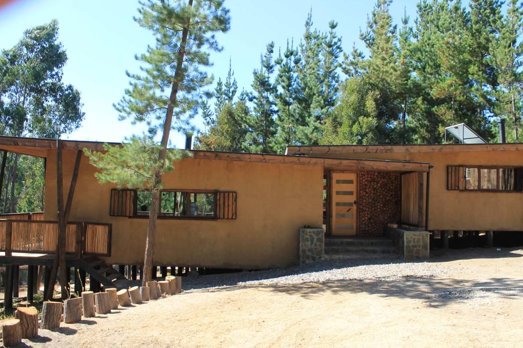 Casa de Fardos Casas de estilo rústico de Kimche Arquitectos Rústico