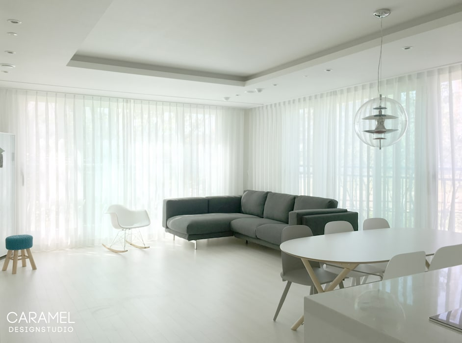 카라멜 디자인 스튜디오 Livings de estilo moderno Blanco