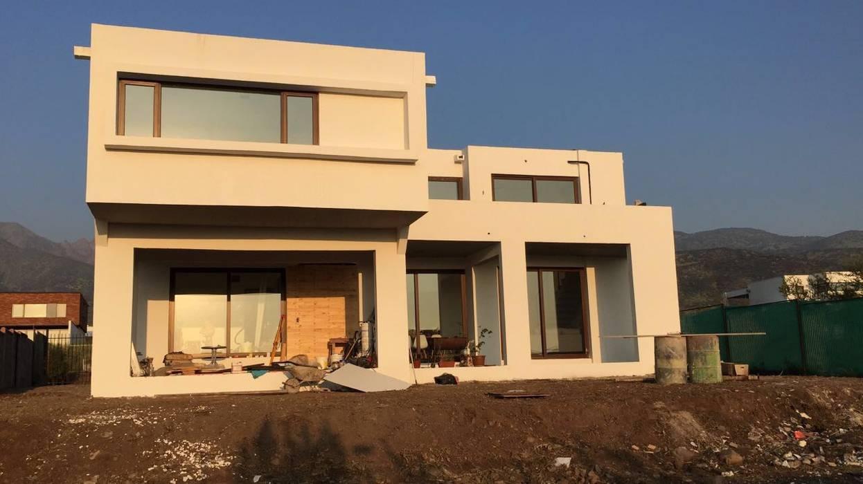Obra Proyecto casa BL piedra roja - Chicureo. de MJO ArqDesign Moderno Ladrillos