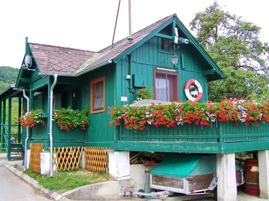 Ferienhaus in fröhlichen Farben:  Holzhaus von Tanja Mason Fotografie