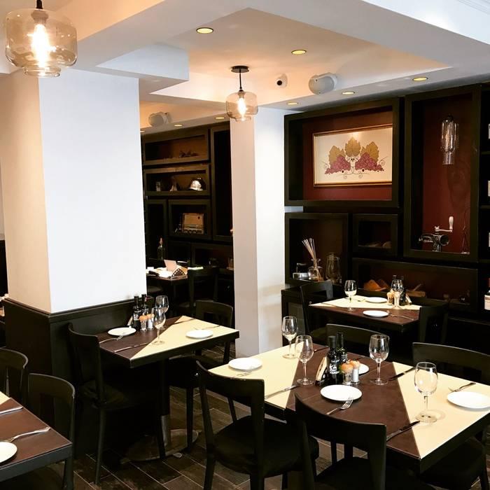 Restaurant antaño / sommelier de PICHARA + RIOS arquitectos Ecléctico Madera Acabado en madera