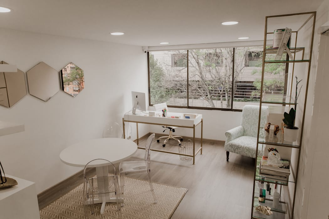 Oficinas Beheit: Estudios y despachos de estilo  por Redesign Studio
