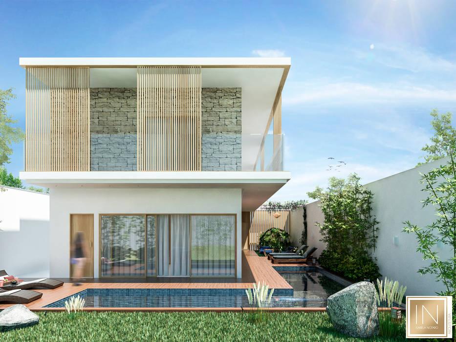 Casa Landscape: Condomínios  por Isabela Notaro Arquitetura e Interiores