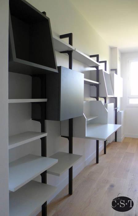 Bibliothèque modulaire sur montants métalliques: Bureau de style  par La C.S.T