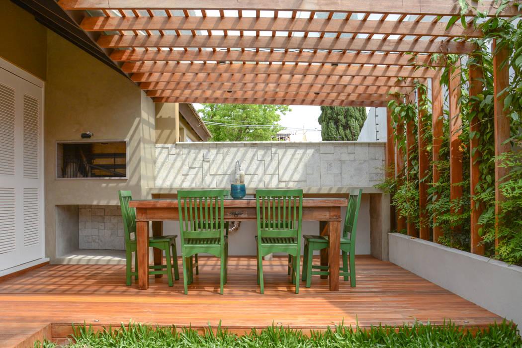 Residência KES Jardins ecléticos por Bloco Z Arquitetura Eclético