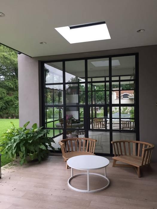 Casas unifamiliares de estilo  por Estudio Dillon Terzaghi Arquitectura - Pilar,