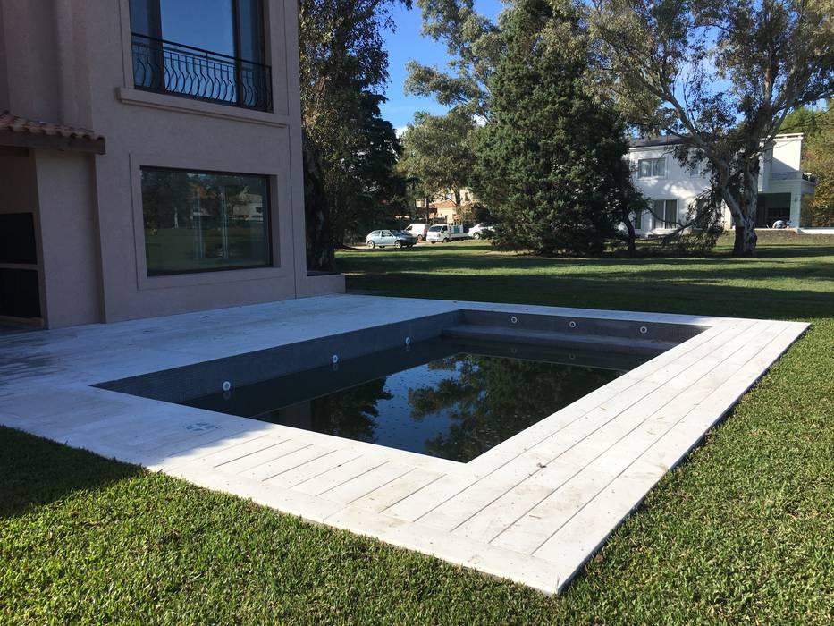 CASA E SAINT THOMAS CC: Piletas de jardín de estilo  por Estudio Dillon Terzaghi Arquitectura - Pilar